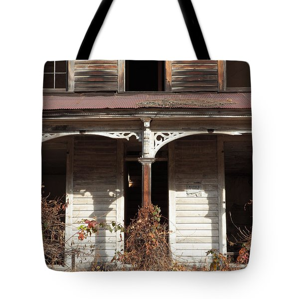 Abandoned House Facade Rusty Porch Roof Tote Bag by John Stephens