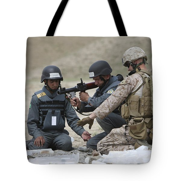 Afghan Police Students Assemble A Rpg-7 Tote Bag by Terry Moore