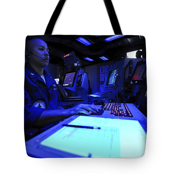 Air Traffic Controller Stands Watch Tote Bag by Stocktrek Images
