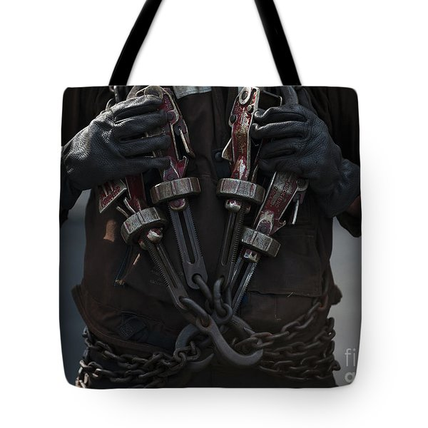Airman Carries Aircraft Tie-down Chains Tote Bag by Stocktrek Images
