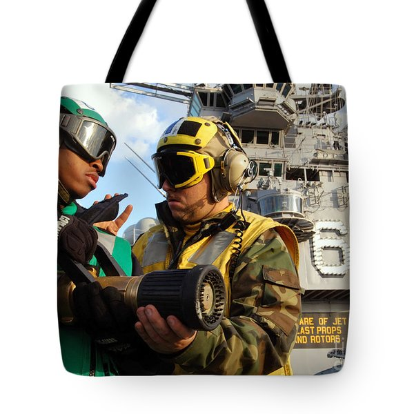 Airman Receives Proper Fire Fighting Tote Bag by Stocktrek Images