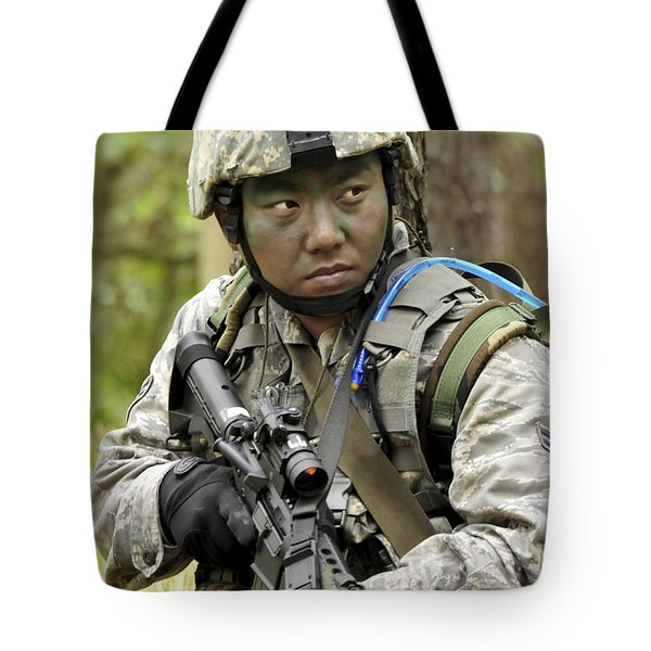 Airman Scans The Tree Line For Enemy Tote Bag by Stocktrek Images