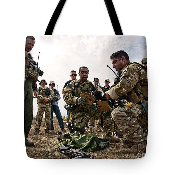 Airmen Explain Their Evidence Gathering Tote Bag by Stocktrek Images