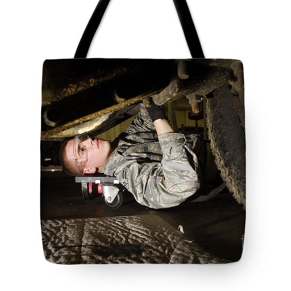 An Airman Inspects The Undercarriage Tote Bag by Stocktrek Images