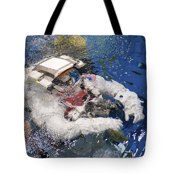 An Astronaut Is Submerged In The Water Tote Bag by Stocktrek Images