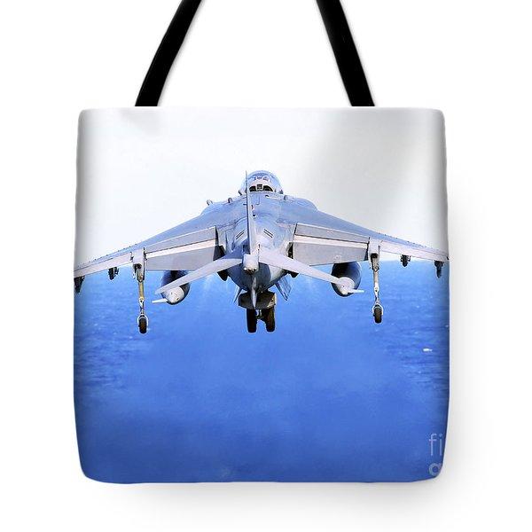 An Av-8b Harrier Jet Launches Tote Bag by Stocktrek Images