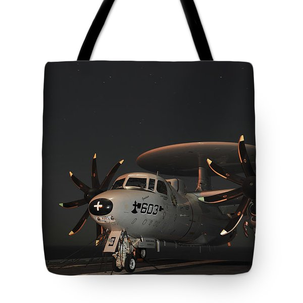 An E-2c Hawkeye Is Chained Tote Bag by Stocktrek Images