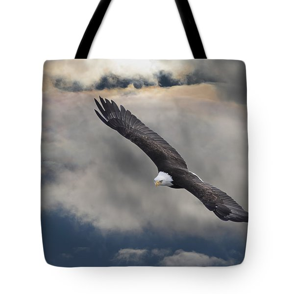 An Eagle In Flight Rising Above The Tote Bag by Robert Bartow