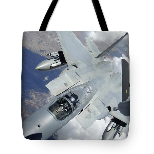 An F-15 Eagle Pulls Away From A Kc-135 Tote Bag by Stocktrek Images