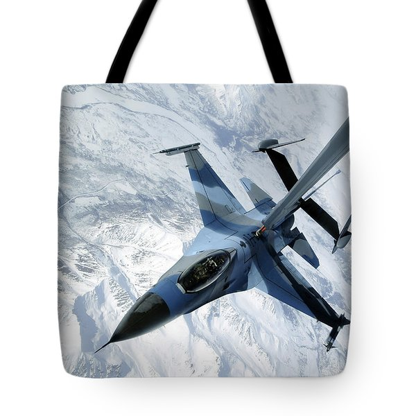 An F-16 Aggressor Sits In Contact Tote Bag by Stocktrek Images