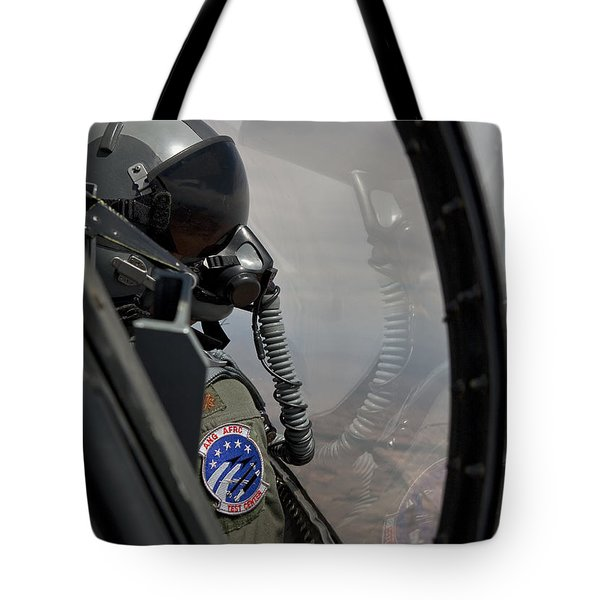 An F-16 Pilot Checks The Position Tote Bag by HIGH-G Productions