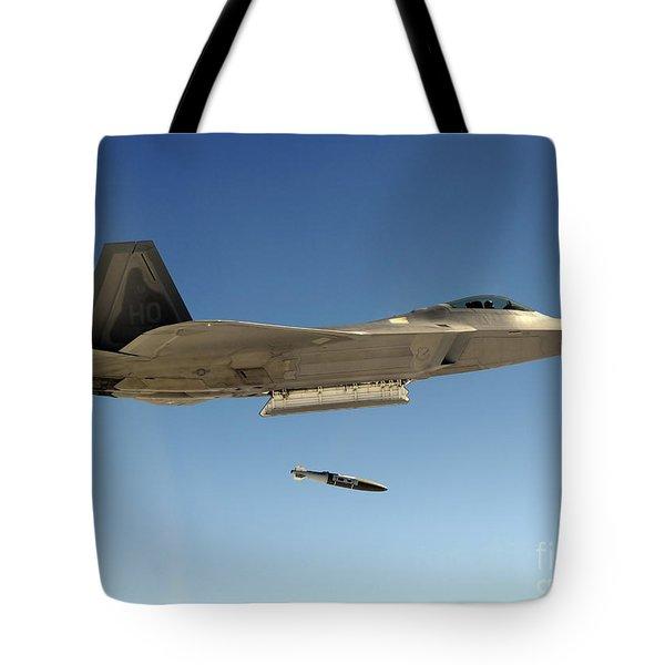 An F-22a Raptor Drops A Gbu-32 Bomb Tote Bag by Stocktrek Images