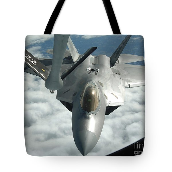 An F-22a Raptor Refuels With A Kc-135 Tote Bag by Stocktrek Images