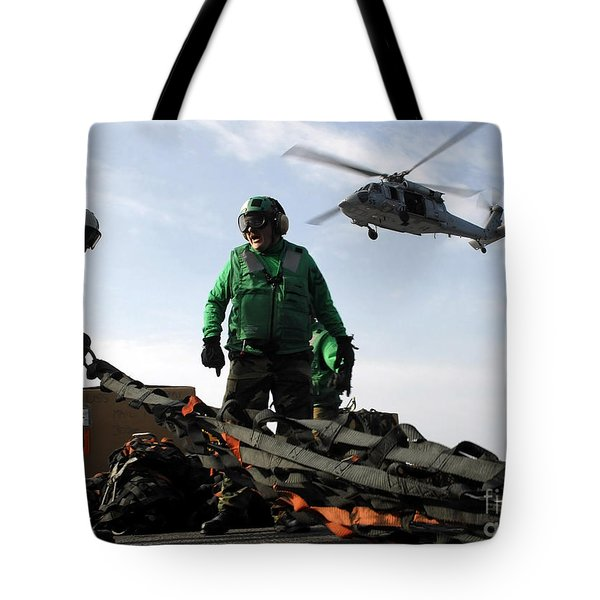 An Mh-60s Seahawk Passes Over Two Tote Bag by Stocktrek Images