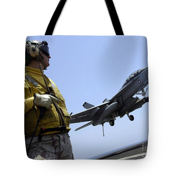 An Officer Observes An Fa-18f Super Tote Bag by Stocktrek Images