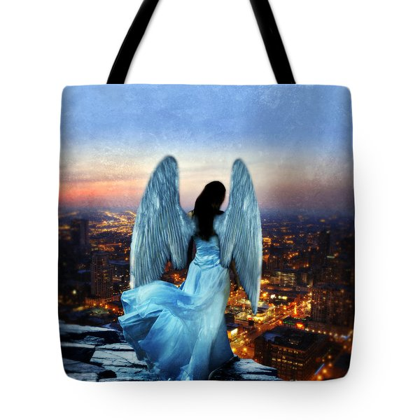 Angel On Rocky Ledge Above City At Night Tote Bag by Jill Battaglia