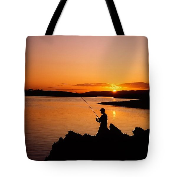 Angler At Sunset, Roaring Water Bay, Co Tote Bag by The Irish Image Collection