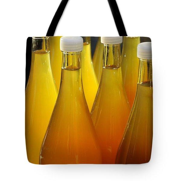 Apple juice in bottles Tote Bag by Matthias Hauser