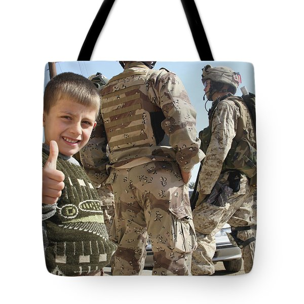 As A Father Is Questioned By Marines Tote Bag by Stocktrek Images