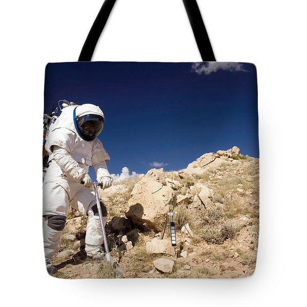 Astronaut Stands Beside A Core Sampling Tote Bag by Stocktrek Images