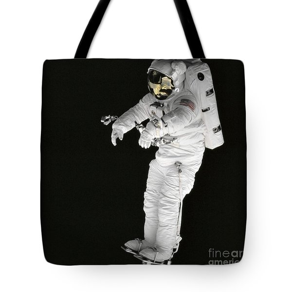 Astronaut Stands On A Portable Foot Tote Bag by Stocktrek Images