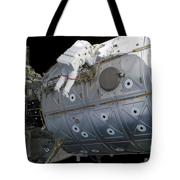 Astronaut Traverses Along The Destiny Tote Bag by Stocktrek Images