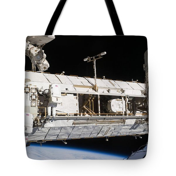 Astronauts Continue Maintenance Tote Bag by Stocktrek Images