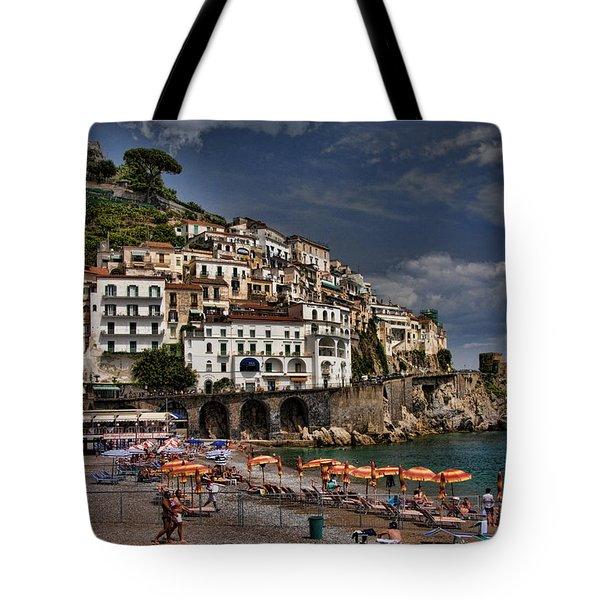 Beach scene in Amalfi on the Amalfi Coast in Italy Tote Bag by David Smith
