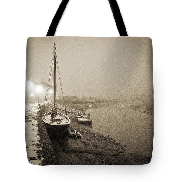 Boat on wintry quay Tote Bag by Gary Eason