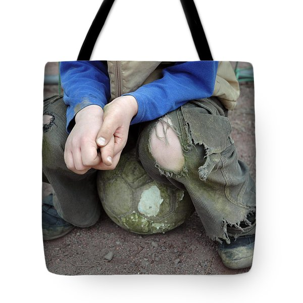 Boy Sitting On Ball - Torn Trousers Tote Bag by Matthias Hauser