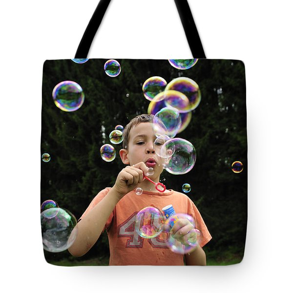 Boy with colorful bubbles Tote Bag by Matthias Hauser