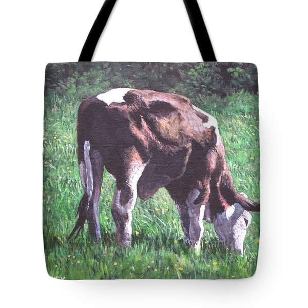 Brown And White Cow Eating Grass Tote Bag by Martin Davey