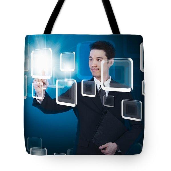 Businessman Pressing Touchscreen Tote Bag by Setsiri Silapasuwanchai
