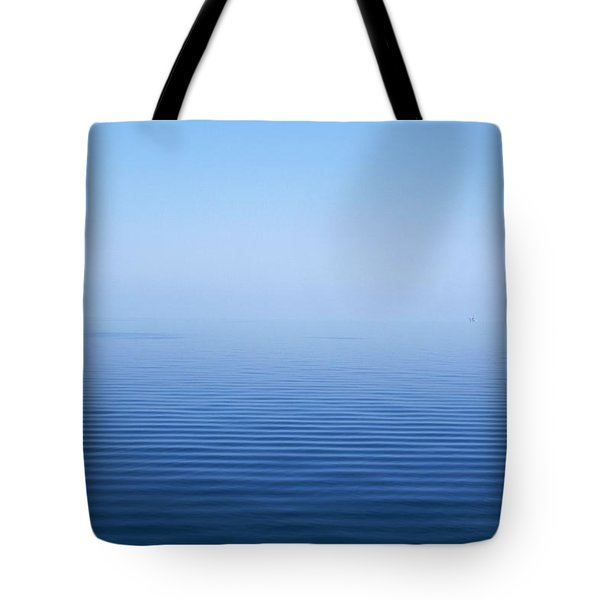 Calm Blue Water Disappearing Into Tote Bag by Axiom Photographic