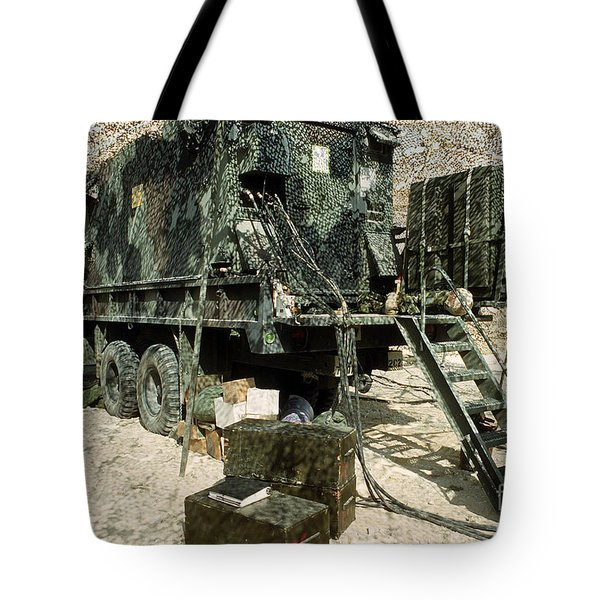 Camouflage Netting Covers A Cargo Truck Tote Bag by Stocktrek Images