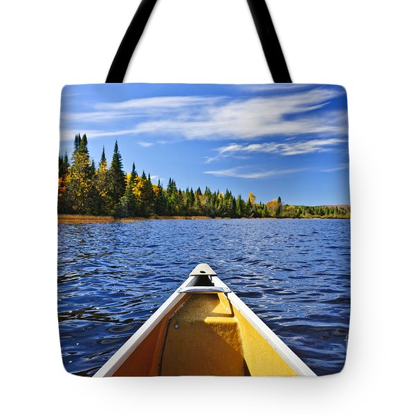 Canoe bow on lake Tote Bag by Elena Elisseeva