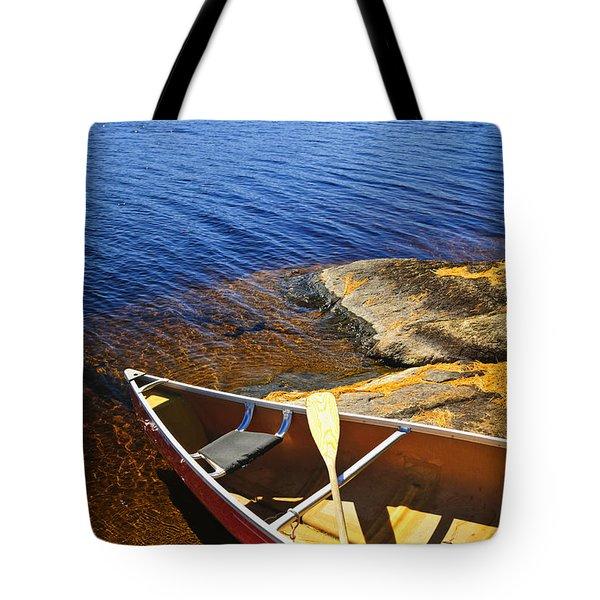 Canoe On Shore Tote Bag by Elena Elisseeva