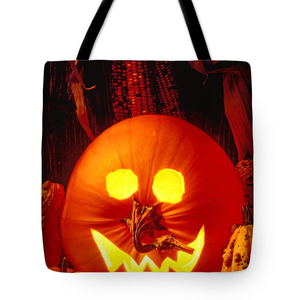 Carved Pumpkin With Fall Leaves Tote Bag by Garry Gay