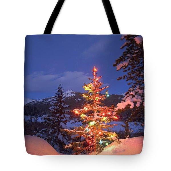 Christmas Tree Outdoors At Night Tote Bag by Carson Ganci