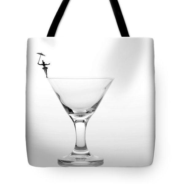 Circus Balance Game On Cup Edge Tote Bag by Paul Ge