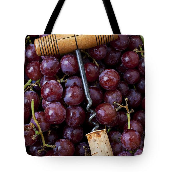 Corkscrew and wine cork on red grapes Tote Bag by Garry Gay