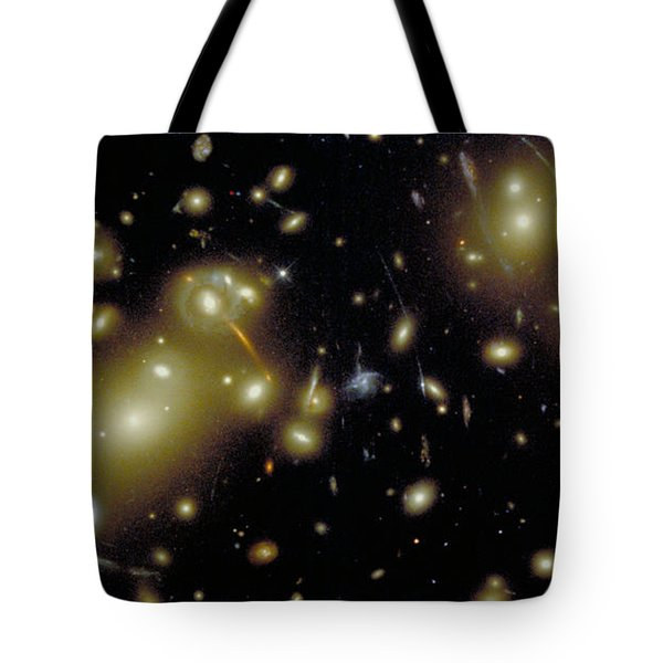 Cosmic Magnifying Glass Tote Bag by STScI/NASA/Science Source