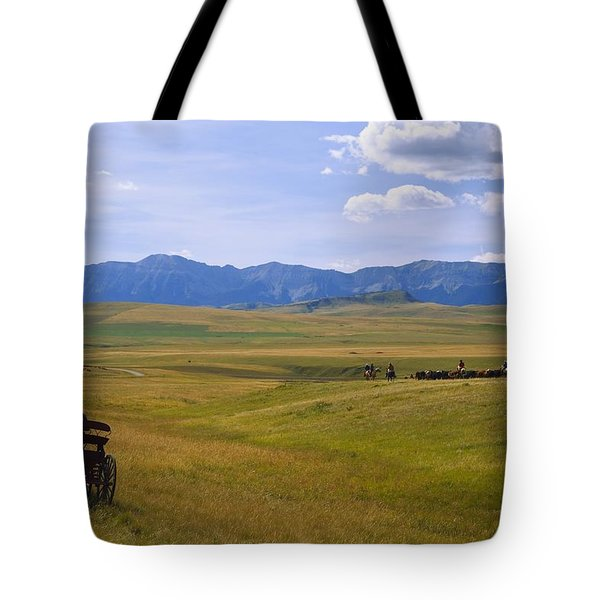 Cowboys And Wagon On A Cattle Drive Tote Bag by Carson Ganci