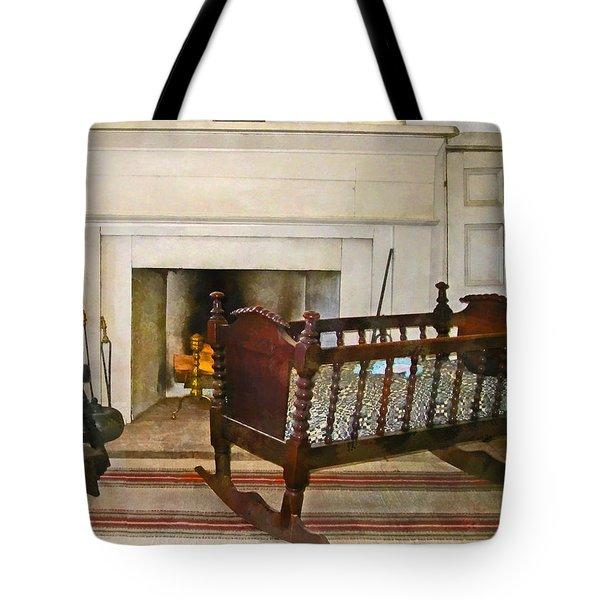 Cradle Near Fireplace Tote Bag by Susan Savad