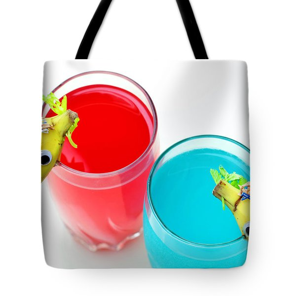 Dolphin Surfing In Colorful Sea Tote Bag by Paul Ge