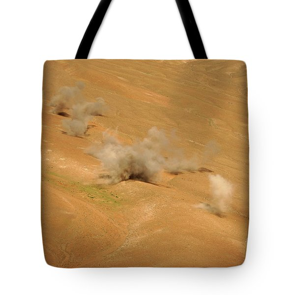 Dust Rises From The Impact Points Of Kp Tote Bag by Stocktrek Images