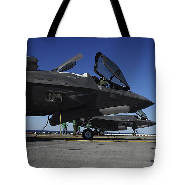 F-35b Lightning Ii Variants Are Secured Tote Bag by Stocktrek Images