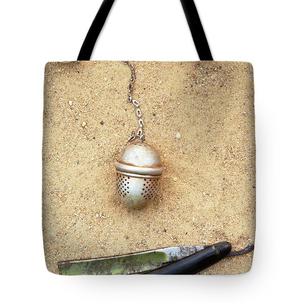 face on the sand Tote Bag by Michal Boubin