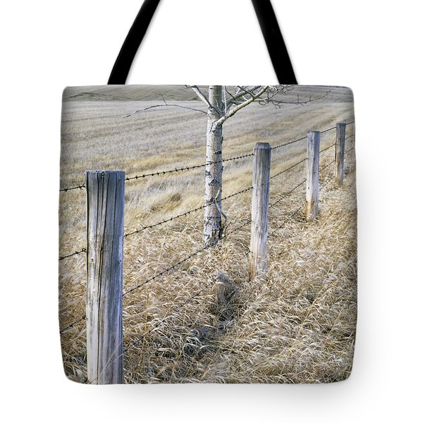 Fenceline And Cropland In Late Fall Tote Bag by Darwin Wiggett