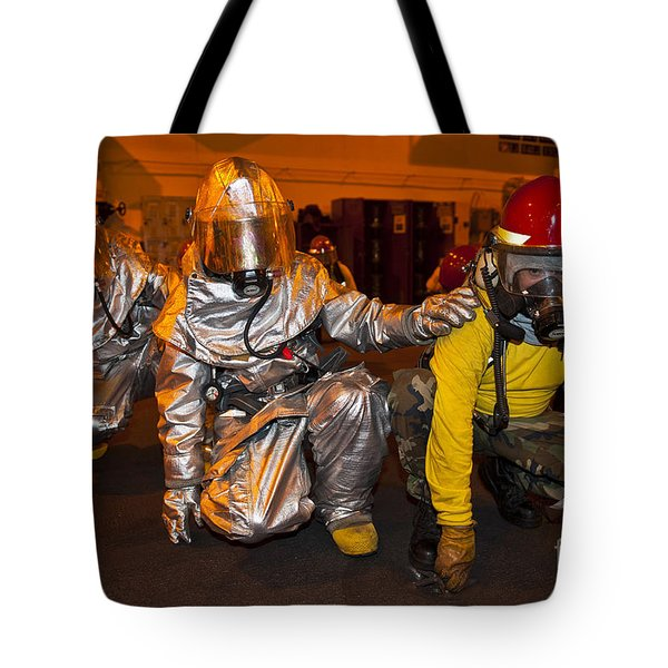 Firemen Brace For Shock Tote Bag by Stocktrek Images